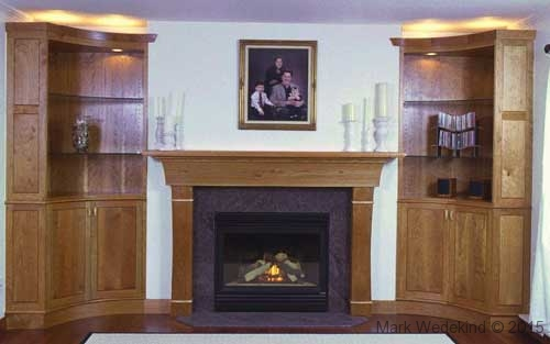 Fireplace mantel and curved front cabinets