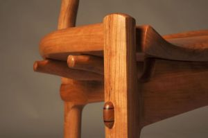 Detail of 3 Legged Sculpted Cherry Stool