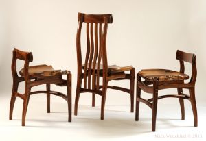 High and low back walnut dining chairs